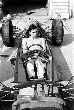 "Jim Clark squeezes into the Lotus 25 at Monza in 1962. Before ""ground-effects"" cars . . . when open-wheeled racing was true! The Lotus 25 was the very first 'monocoque' constructed F1 car...and the rest is history."