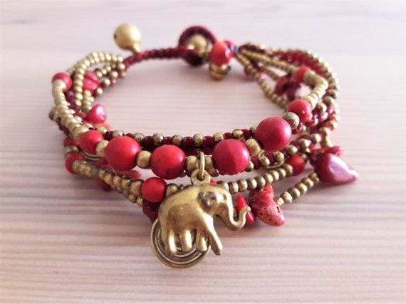 Welcome to Bohemian Style Thai Elephant Collection!  Youre looking at a one-of-a-kind, 5-strand red bracelet with elephant charm. Each line is a different design of red coral, red howlite stones, featuring gold brass beads and adornments.  www.bohemianstyleshop.etsy.com