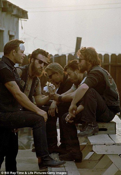 Members of motorcycle gang Hell's Angels (incl. one w. bandaged head)