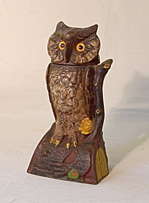 Cast iron mechanical owl toy penny bank c1900