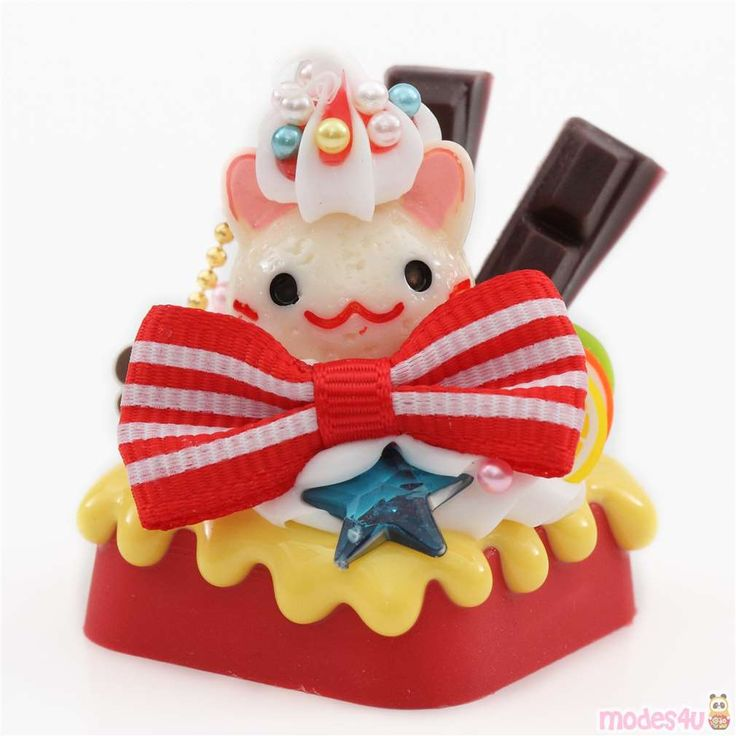 light cream color cat face red bow chocolate fruit dessert ...