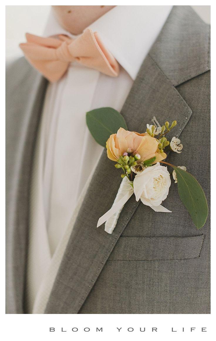 Boutoniere with ranunculus and spray rose  photographer: Alexandra Vonk floral design: Bloom Your Life venue: Heerenhuis