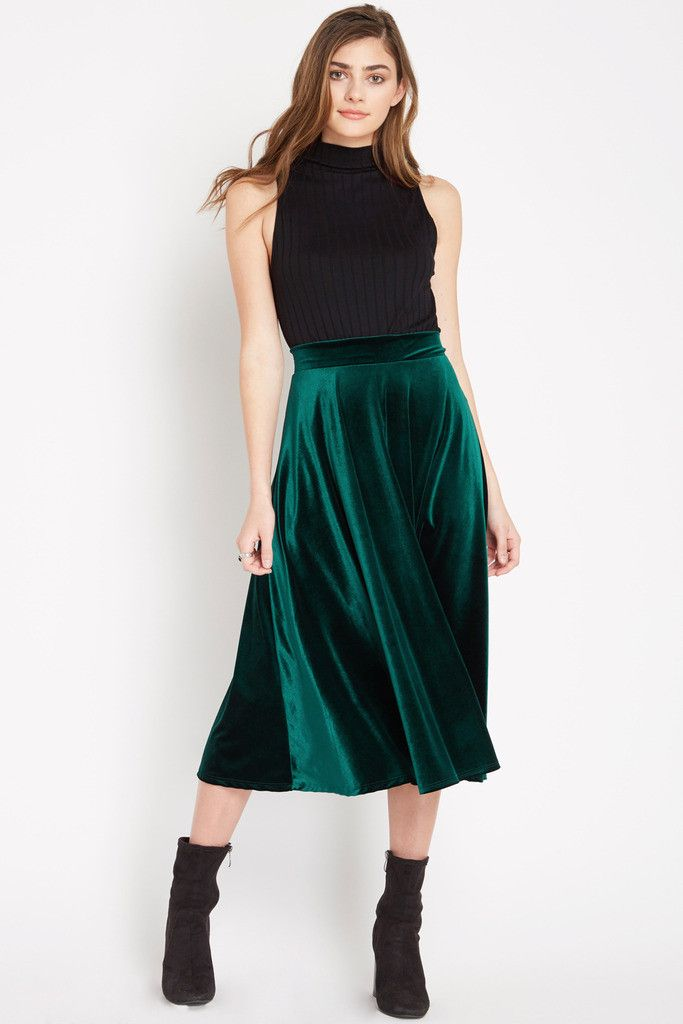 Details Comfortable velvet material creates an elegant look for this flowy midi skirt. Skirt is unlined. Content & Care • 90% Polyester 10% Spandex • Machine Wash Cold • Made in USA of Imported Fabric