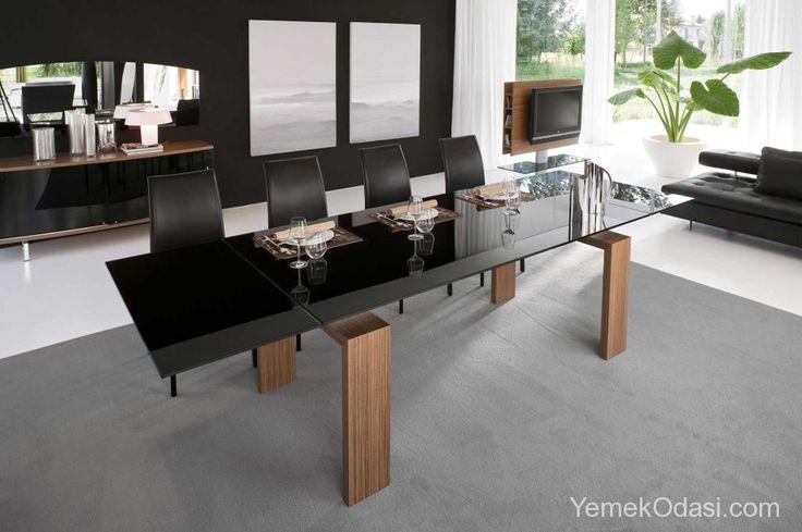 Siyah Yemek Masaları Siyah camı ve ahşap ayaklarıyla estetik bir görünüm katan siyah yemek masasında açılabilir kanatları sayesinde 12 kişiyi rahatlıkla ağırlayabilir, isterseniz kanatları kapalı da kullanabilirsiniz.    Yemek masasında, sandalyelerin ayakları masaya muntazam bir şekilde girmez ve dağınık görünü ... http://www.yemekodasi.com/siyah-yemek-masalari/
