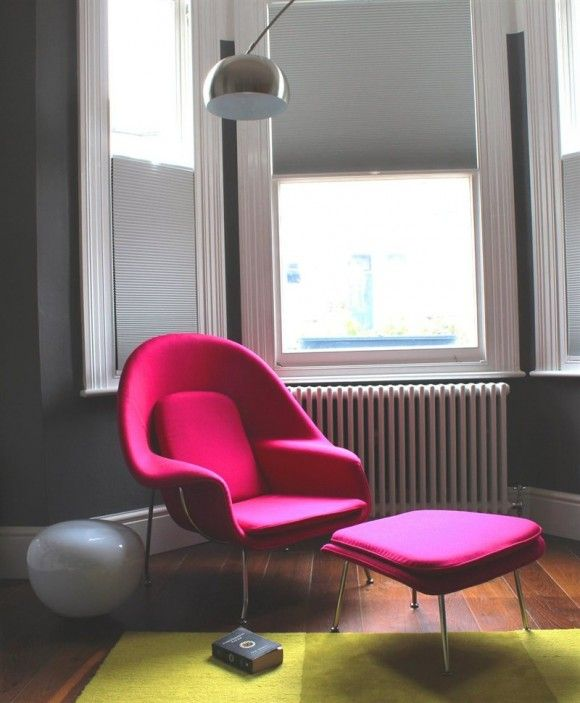 What a terrific setting for this classic MCM piece, the Eero Saarinen Womb Chair. It looks great against the dark wall, paired with bright citron Flor tiles.