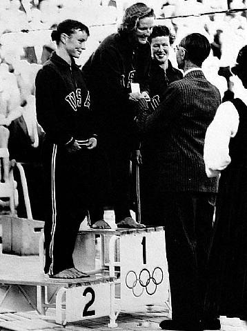 1952. Pat McCormick, USA Diving, receiving her gold at the Olympics in Helsinki, Finland