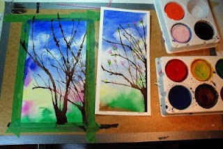 that artist woman: How to Paint Spring Trees  wet watercolour paper; blue paint wash down; blot cloud blotches with tissue; blow ink or paint tree silouhette; cotton bud for blossom and leaves