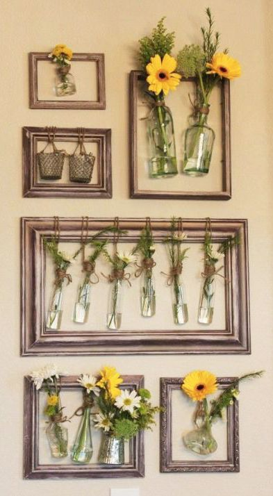 fill your walls with fresh flowers by hanging jars inside revitalized old picture frames to make