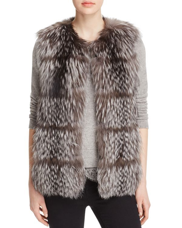 Impeccable construction meets statement style in this decadent fox fur vest from Maximilian. Detailed with horizontal insets, this versatile yet look-at-me-now topper is available exclusively at Bloom