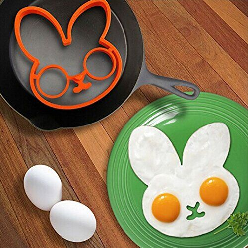 Make your whole eggs cute with our lovely little white rabbit Egg Shaper.   Start your day with a fried side of fun.   This at hand frame shaped and moulds two eggs into attractive egg art.   Made of heat-resistant silicone rubber.   Withstands temperatures of -20°F