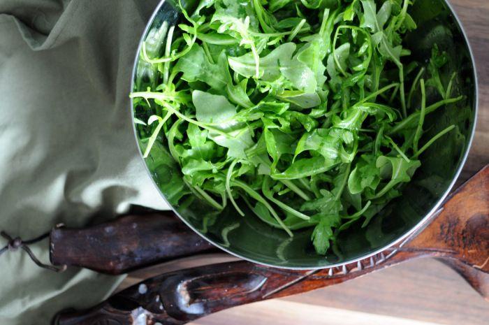 arugula salad with lemon juice, olive oil and sea salt.
