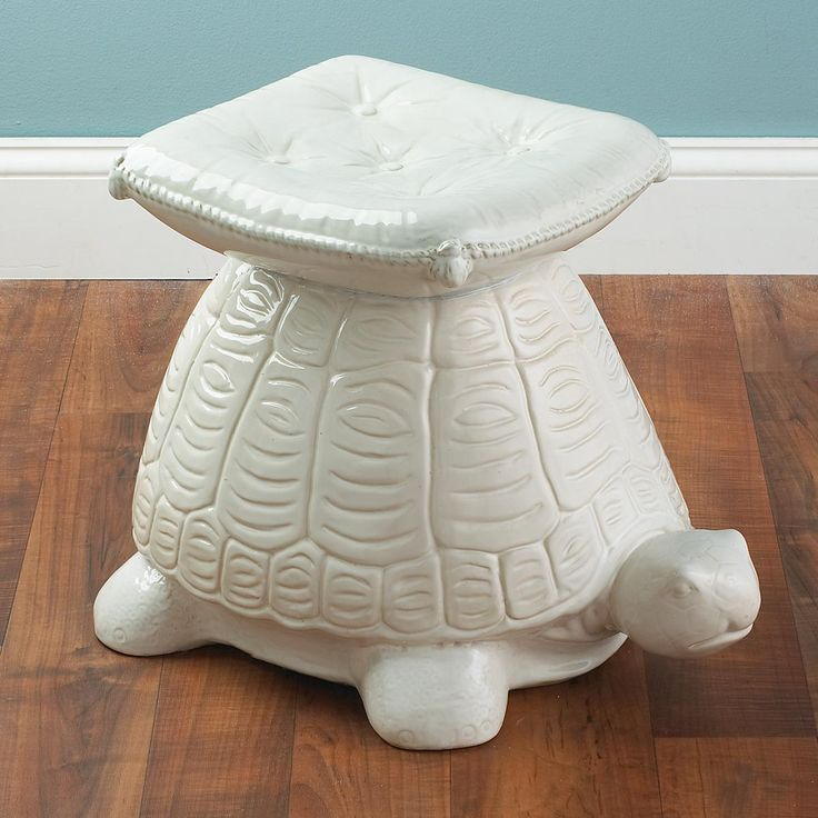 Ceramic Turtle Stool A White Ceramic Turtle Is Topped With