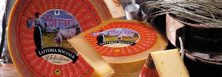 """Bitto DOP El nombre Bitto se remonta a la """"bitu"""" celta, que significa eterno. Este queso sólo puede producirse durante la temporada de verano, en los pastos de alta montaña, ya que sus características dependen de la calidad de los pastos consumidos por las vacas, que van desde los pastos de dehesa. Bitto se produce exclusivamente con leche entera de vaca obtenida de razas tradicionales de la zona a la que se puede añadir la leche de cabra en no más de 10% .El Bitto es cilíndrico, liso, con…"""