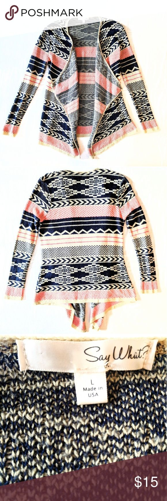 Aztec print cardigan This cardigan is a fun navy, coral and cream colored print. Barely worn and in mint condition. It doesn't have buttons, but it drapes in the front and looks very pretty layered.  Note: Although it is a large, the sleeves seem to be a little tight at the top but the material is stretchy and forgiving Say What? Sweaters Cardigans