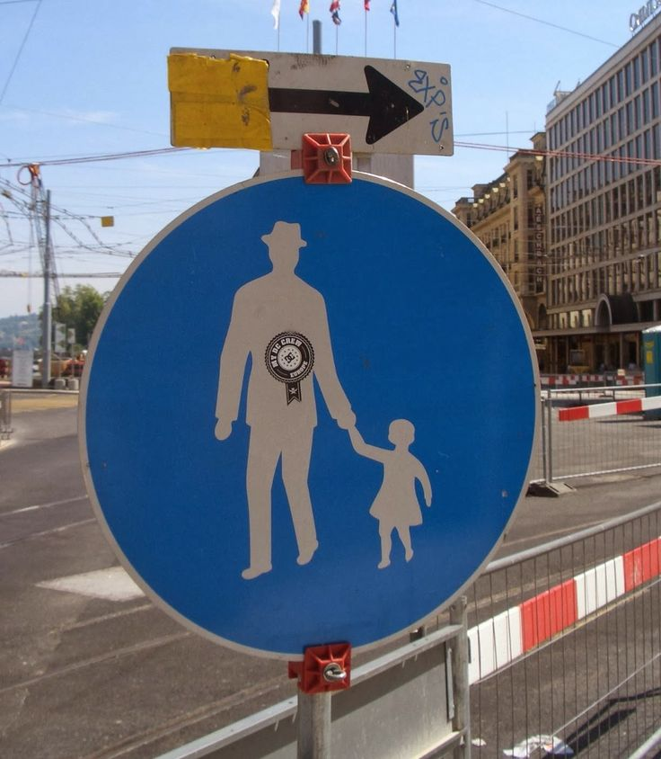 Exception to the rule: male figure with child (photo taken in Geneva, Switzerland)