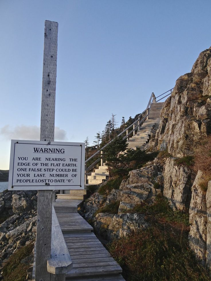 Newfoundland: A warning sign greets visitors to Fogo Island's Brimstone Head, which members of the Flat Earth Society believe is one of the four corners of the earth.