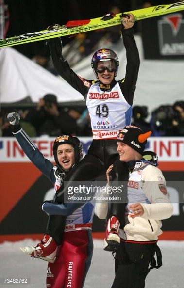 Adam Malysz of Poland celebrates after winning the Gold Medal with Silver Medalist Simon Ammann of Switzerland and Thomas Morgenstern of Austria how...