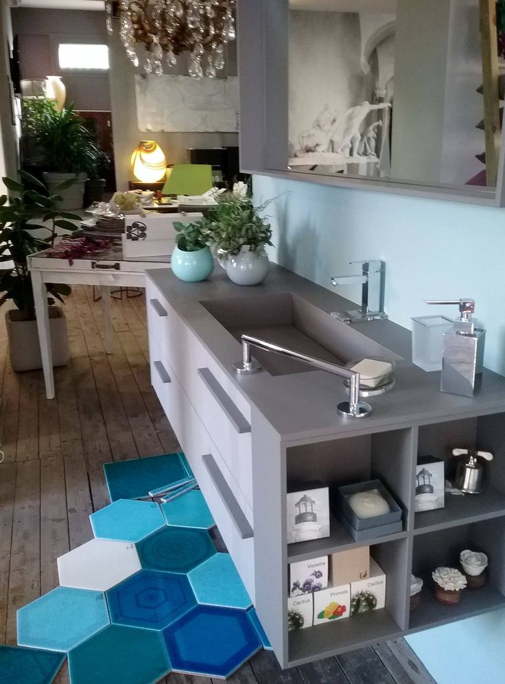 """This week we're in Italy: here's Sense in solid sandblasted Teak """"Cenere"""" and """"Grigio Londra"""" Fenix NTM, in the Laccatolucido exhibit in Piombino. How do you like the combination of pastel colors?"""
