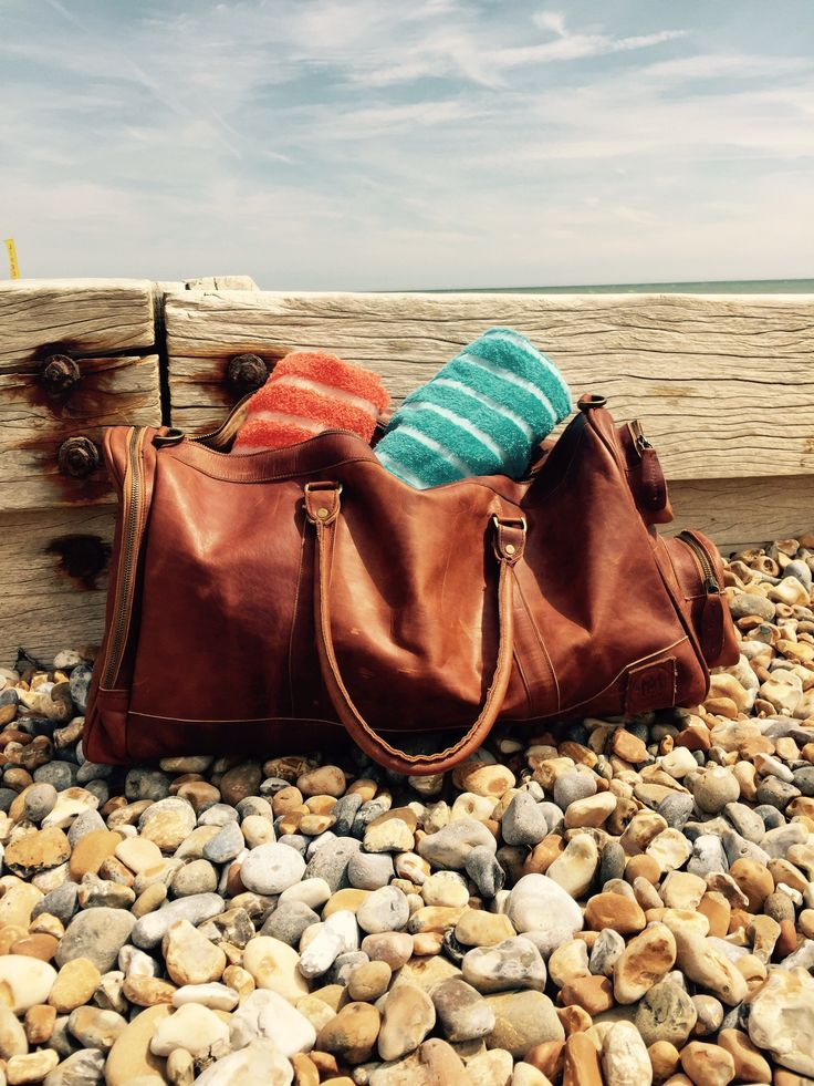 Beach towels in the perfect beach bag - Deep Weekender from MAHI Leather