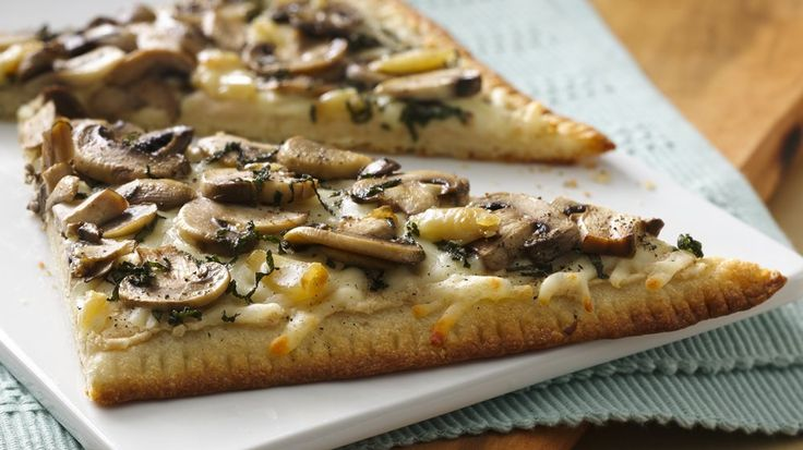 Make cheesy restaurant-style flatbread at home! It's a breeze with short-cut pizza dough.