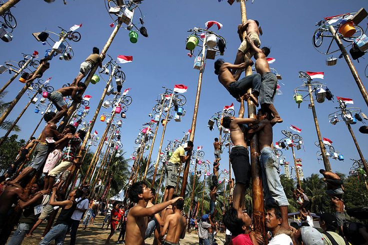 Climbing race in Jakarta, Indonesia; this occurs during the country's independence celebrations. Photo via LATimes.com