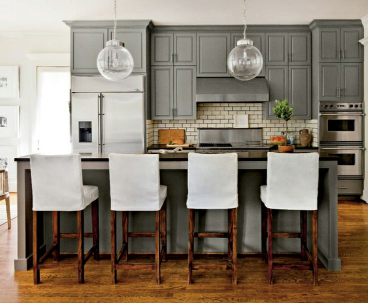 Lights slipcovered barstools with rustic wood legs and for Kitchen cabinets with legs