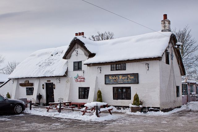 The Scotch Piper Inn, Lydiate, Merseyside, England is the oldest pub of the historic county of Lancashire.  The building dates from 1320 and is a Grade ll listed building.  The building retains a thatched roof.   The pub is located 10 miles from Liverpool and it stands close to the site of Lydiate Hall.  Tony Blair the British Prime Minister made a visit to the pub in 1999 during his first term.