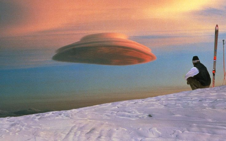 Weird Cloud Atlas: a collection of spectacular cloud formations,lenticular cloud, Mauna Kea, Hawaii, USPicture: Science Photo Library / Rex Features