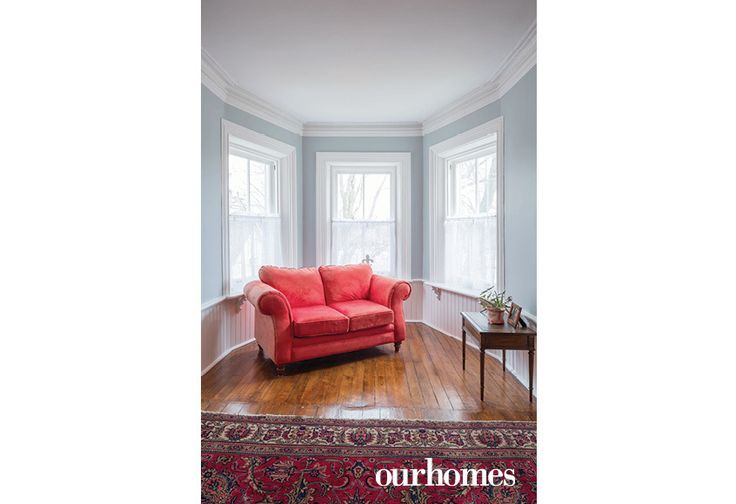 Original wooden flooring was preserved during restoration of the master bedroom where wainscotting and big windows create a light-filled alcove.   See more of this home in OUR HOMES Peterborough Early Summer 2016 http://www.ourhomes.ca/articles/build/article/180yearold-cobourg-loyalist-home-restored