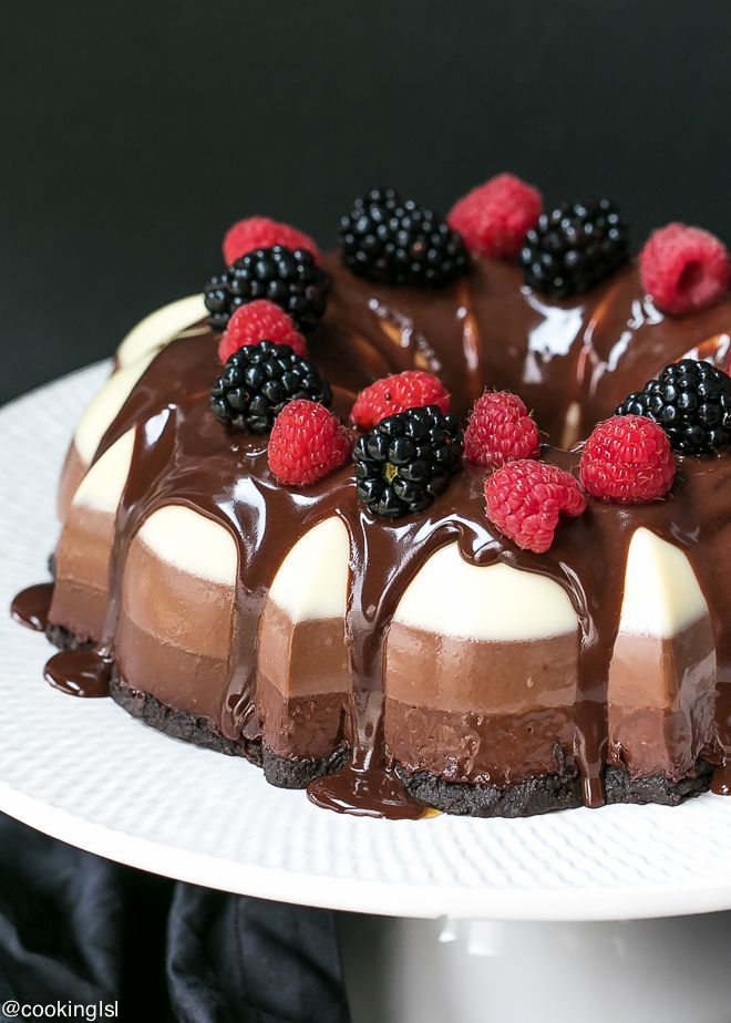 No Bake Three Chocolate Cake Recipe - made in a bundt pan, layers of white, milk and dark chocolate and Oreo cookie crust.