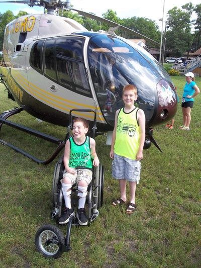 Kids (and their parents) love the helicopter landing provided by the Lake County Sheriff's Dept. at the Public Enemy 5K Run & Walk at the Lake County Fairgrounds in Crown Point, IN.