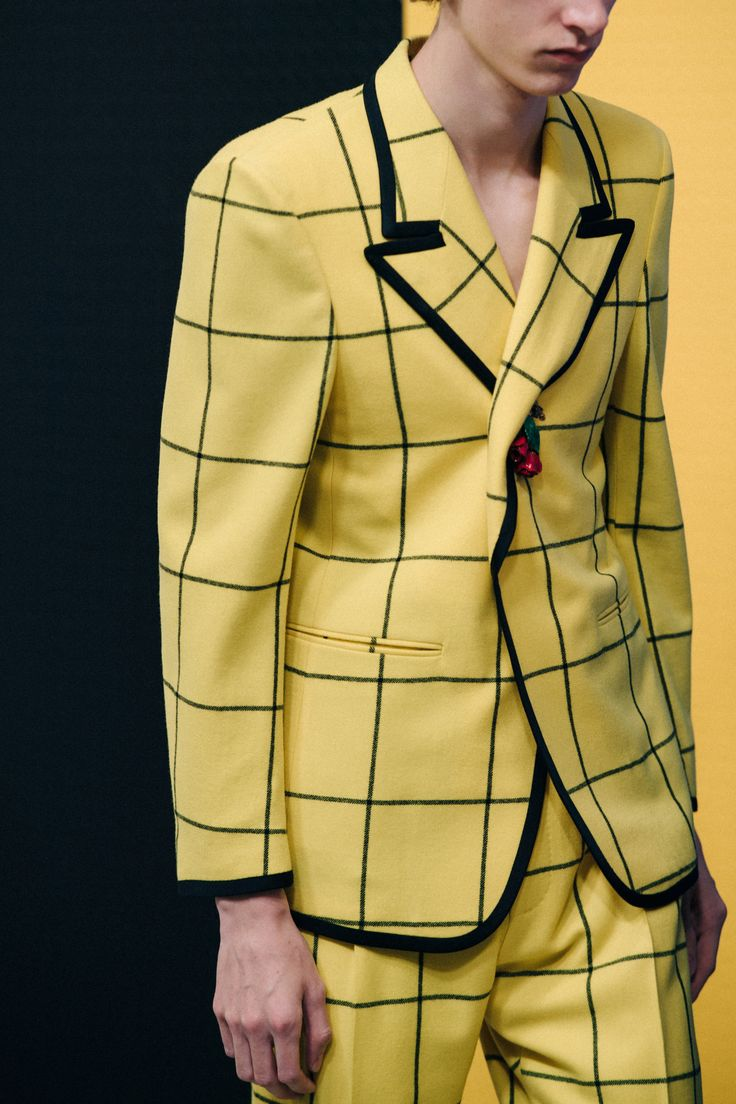 Model backstage at Gucci in yellow suit
