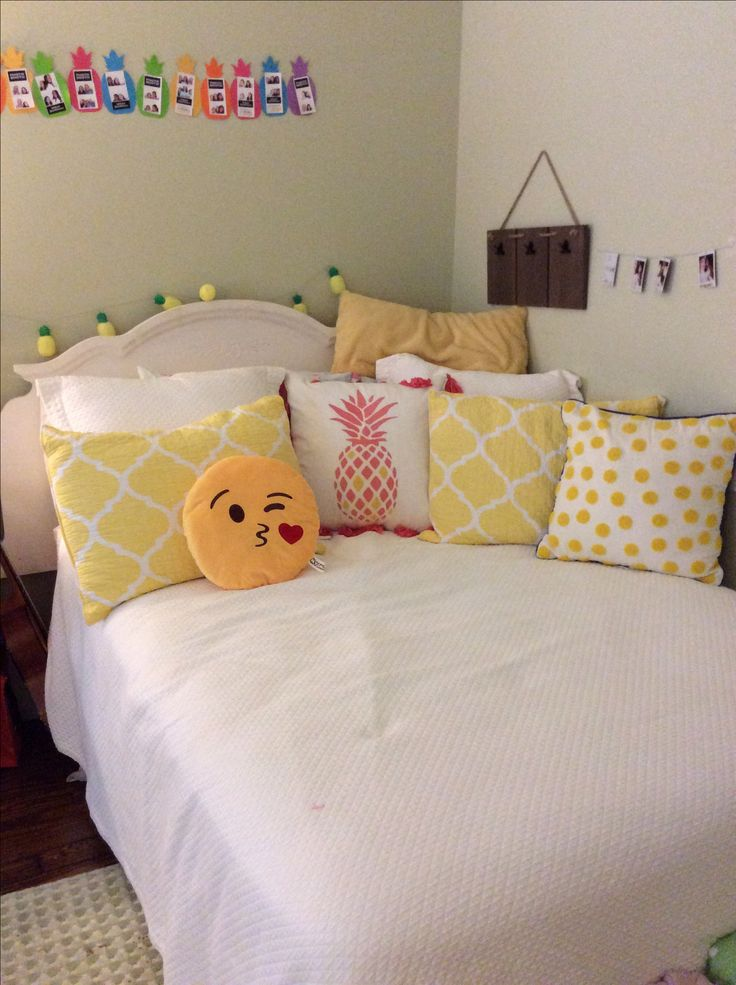 corner bed ideas!! bedding and pillows from~ emoji pillow- the mall  Bedding-pottery barn  Yellow polka dot pillow-target yellow body pillow-homegoods coral pineapple pillow-homegoods yellow throw pillows-homegoods