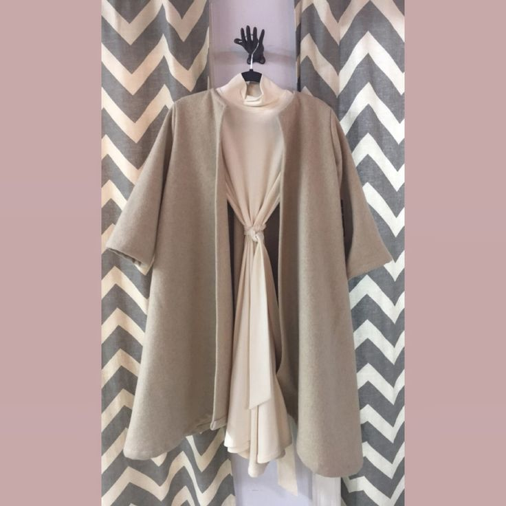 Sooley Betty dress and cashmere flared coat.