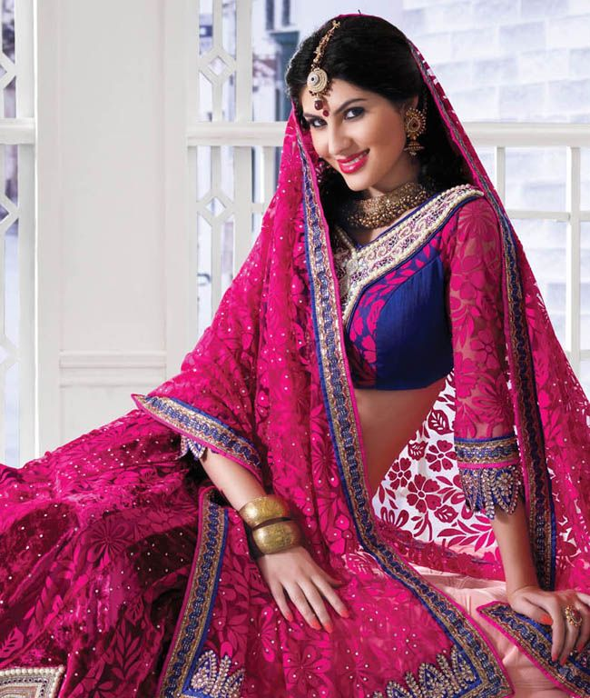 Drape yourself in this lissome and alluring range of lehengas by Hypnotex to become the centre of attention everywhere you go. Be it a kitty party, some function, wedding or a private party- you are sure to be the spite of every woman and the dream of every man. Capture the tradition of elegance with this diversified range that is designed to combine style and sophistication!BRAND: HypnotexCATEGORY: Lehenga, Choli with DupattaARTICLECOLOURMATERIALLENGTHLehengaMagentaVelvet and Net BrassoFits…
