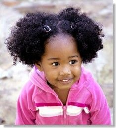Not only is she cute but I am loving her side afro puffs.
