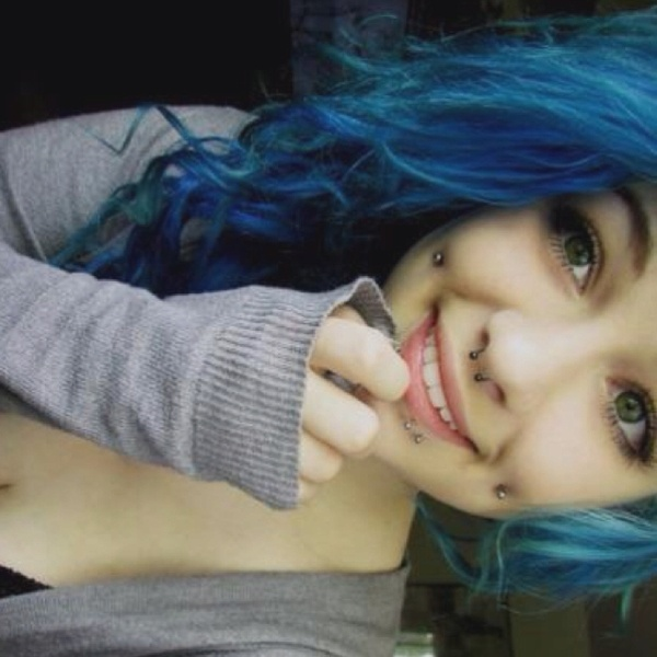 That Face. That Hair. Very fond of the cheek piercings too, and she's absolutely beautiful and they suit her!