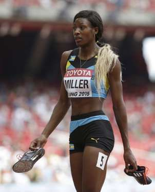 Bahamas' Shaunae Miller walks from the track after competing in heat six of the women's 400m at the ... - (AP Photo/David J. Phillip
