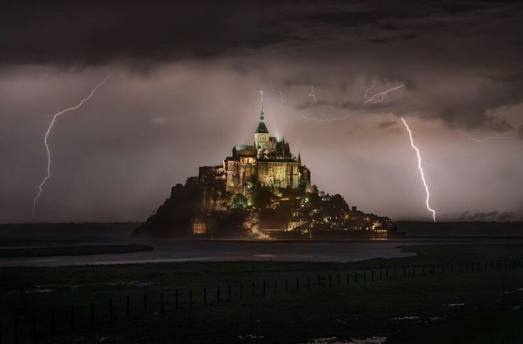 "DECEMBER 6, 2017LUCKY STRIKE  Your Shot photographer Lukas Neuwirth was on his way to photograph Mont-Saint-Michel at sunset when he was caught in a downpour. After the rain stopped, he set up his tripod and captured this scene of lightning striking around the island. ""It was amazing to witness this spectacular sight and mood!"" he remembers.  PHOTOGRAPH BY LUKAS NEUWIRTH,"