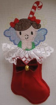 BES414 - SINGLE: Christmas Angel Stocking1 Start early this year with this adorable Christmas Stocking Angel.  The wings have been done using mylar for added Christmas shine while the stocking has been done using our Stump Work Technique!  It is perfect for all your Christmas Projects & Gifts. http://tinyurl.com/hb2o9j3