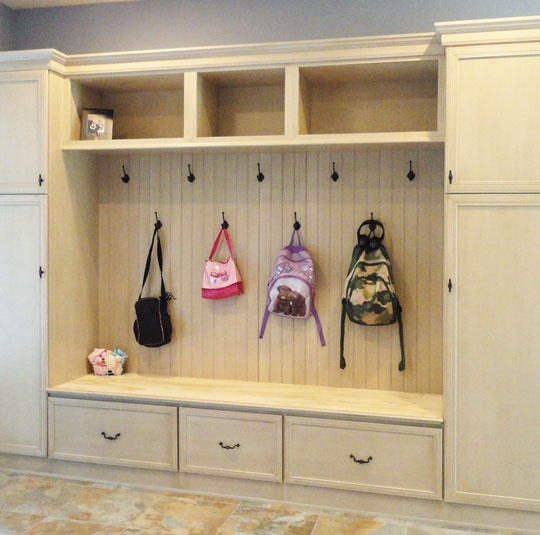 Mud room created with StarMark Cabinetry Brisbane door style in Maple finished…