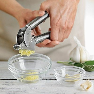 Rsle Garlic Press #WilliamsSonoma   I don't have this garlic press, but it looks pretty powerful!