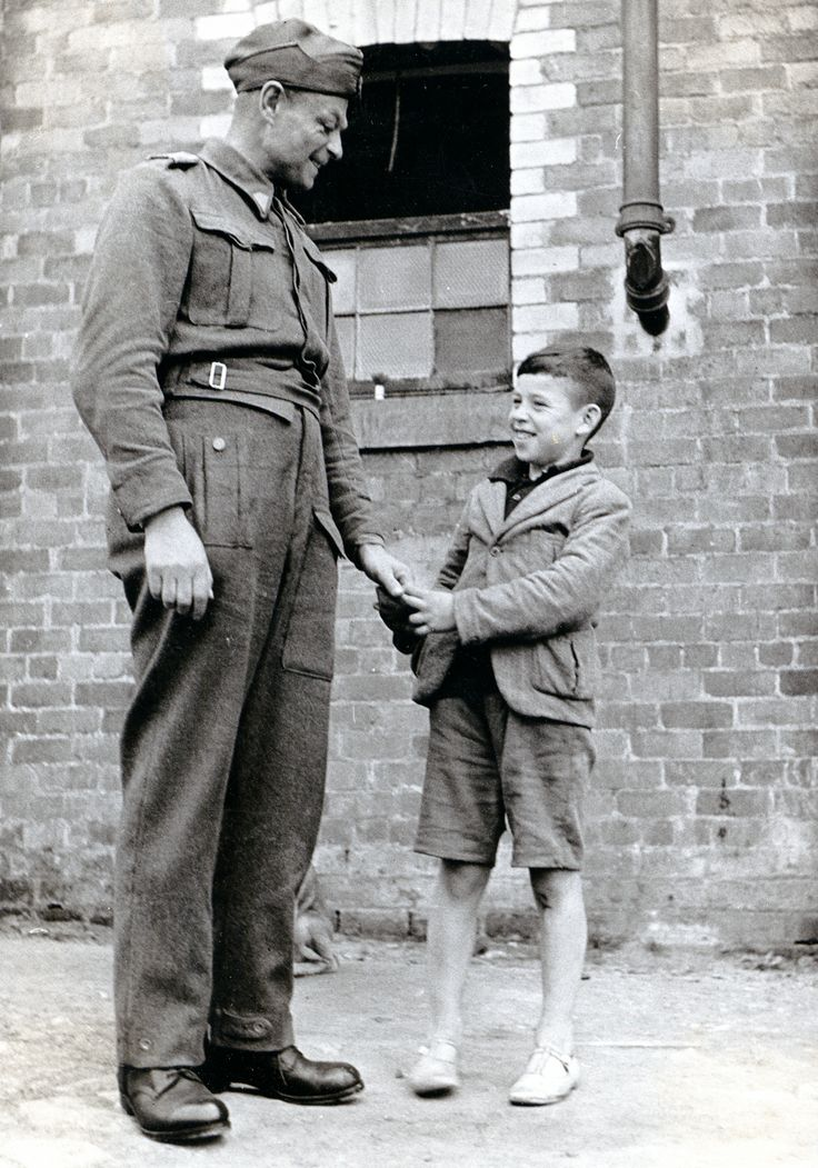 Why they fought - Polish soldier and child, 1940s. (Courtesy of The Polish Institute & Sikorski Museum - London)