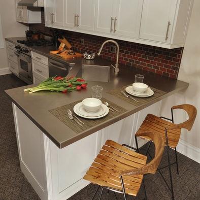 Kitchen Peninsula Design - love the countertop color and the backsplash tiles