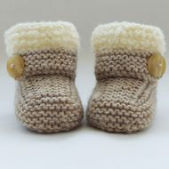These snug little boots/booties have been knitted  with  lovely wool blend yarn in natural shade. They are edged with cream curly textured yarn and have a featured button strap across the front. This is for decoration only. They are warm and comfortabl...