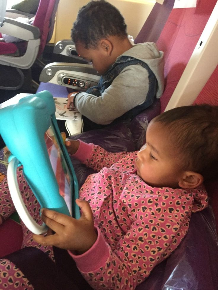 Top 10 Tips to Survive a Solo Long Haul Flight with 2 Kids