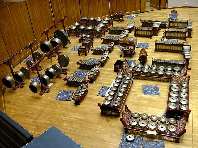 Most of the instruments of a Javanese gamelan ensemble are metal percussion made of brass, iron, or bronze (bronze instruments generally have the best sound). A typical ensemble also has drums, wooden bar percussion instruments, plucked string instruments, bowed string instruments, & bamboo flutes. Gamelan music is a communal art form; playing the music requires a strong sense of rhythm and attention to the music of the whole group.