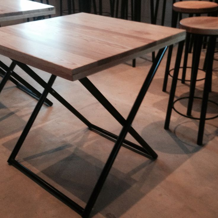 Folding ash and steel dining table