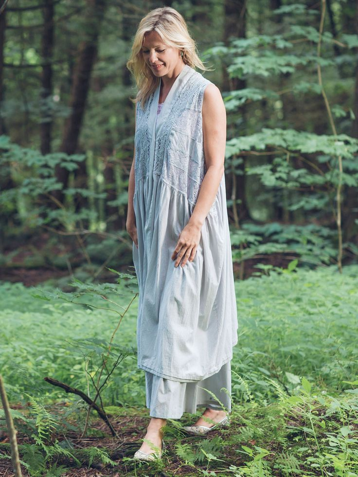 Combine a cup of classic cotton, two tablespoons of country romance and a healthy dash of old fashioned detailing. Et voila! You have the Belgium Vest! Styled extra long, this dreamy garment's embroidered panels are translucent and pieced together in delicate fashion. Soft gathers below the shaped waist enhance the flow of what is truly a one of a kind treasure.