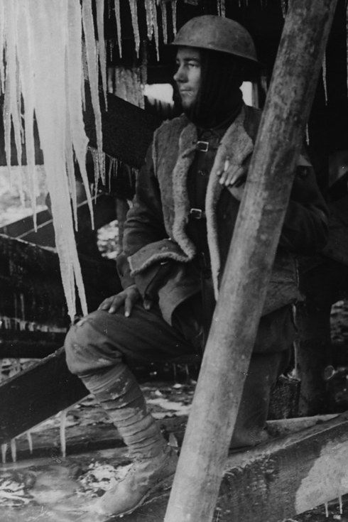 A young soldier surrounded by icicles, France.
